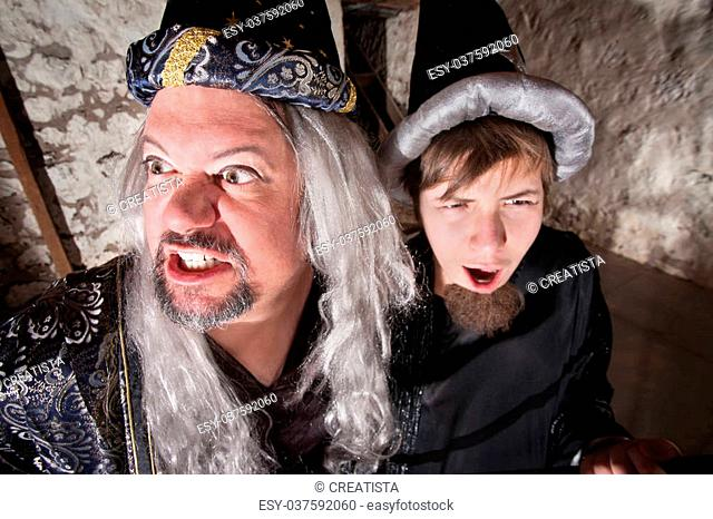 Evil long haired wizard with teenage son