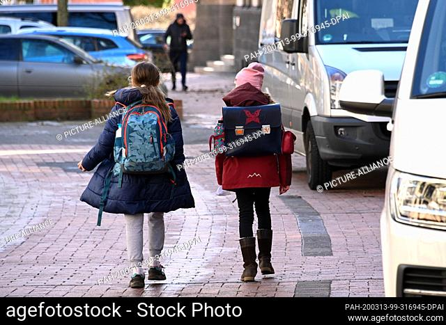 13 March 2020, Hessen, Kassel: Two children go home from school. Hesse, in contrast to other German states, has not yet ordered general school closures due to...