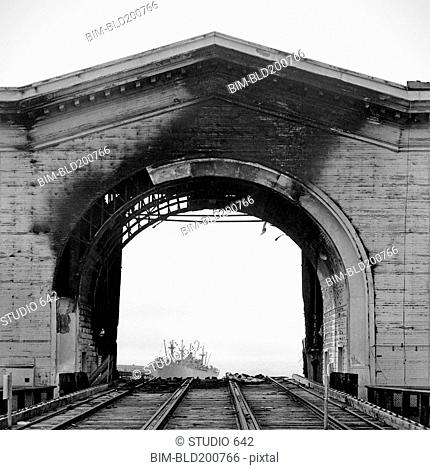 Burned arch over railroad tracks