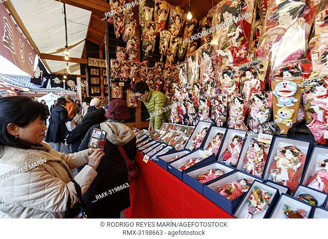 December 17, 2018, Tokyo, Japan - A visitor takes pictures of traditional Hagoita (Battledores) during the Hagoita-Ichi fair at the Sensoji Temple in Asakusa