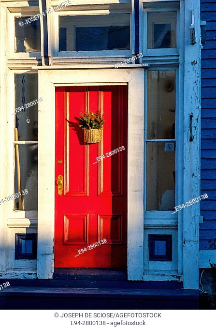 Example of home architecture showing a front red door on a house in Lunenburg, Nova Scotia, Canada