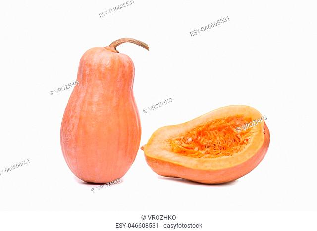 pumpkin fresh vegetable and half sliced squash isolated on a white background