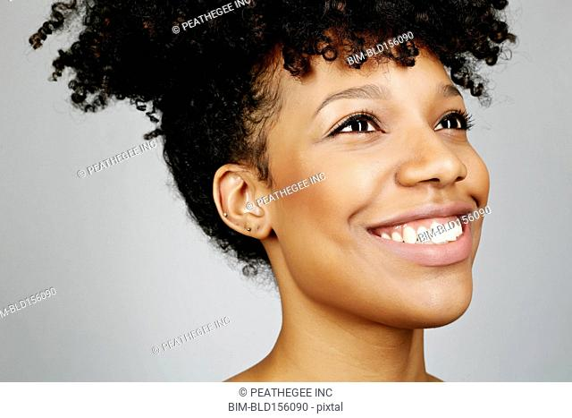 Close up of smiling face of mixed race woman