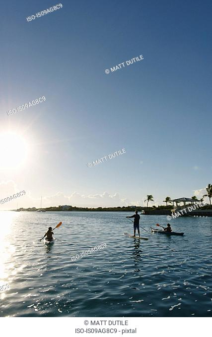 Kayakers and paddle boarder, Providenciales, Turks and Caicos Islands, Caribbean