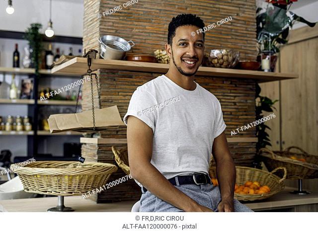 Portrait of man sitting in shop
