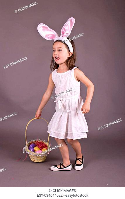 Little girl with Easter egg basket