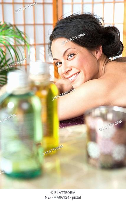 Portrait of beautiful smiling woman in spa
