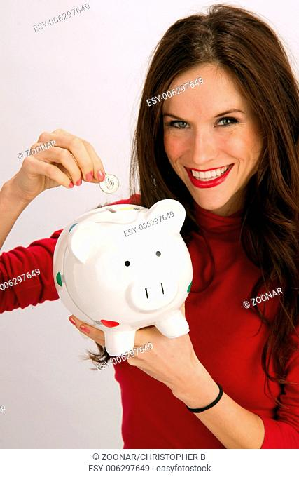 Save a Quarter Smiling Woman Drops Quarter into Piggy Bank