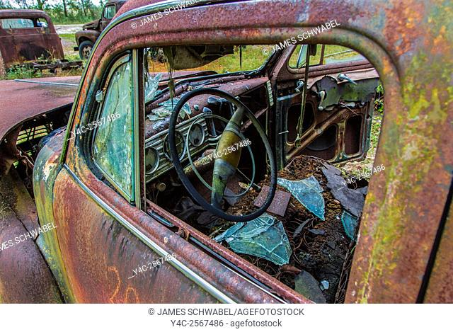 Old rusted trucks and cars