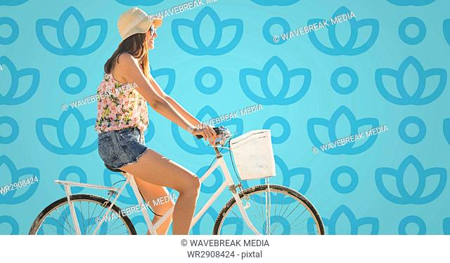Woman on bike against blue floral pattern