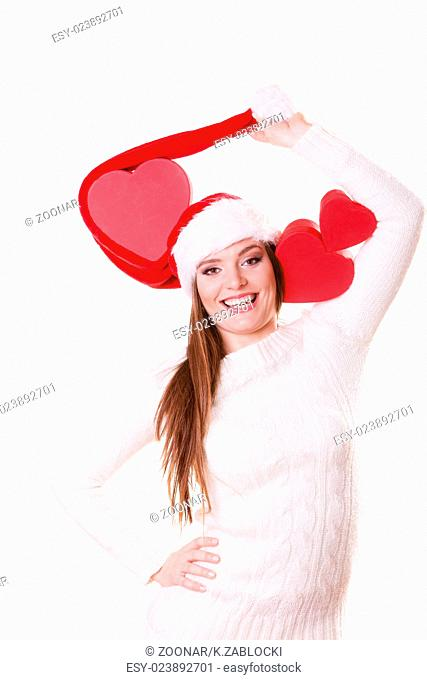 Happy girl in santa hat heart shaped box