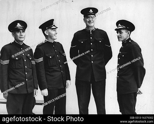 L to R - Sgt. A. Riley (Black Tracker), Sgt. Curran, Con. T. Tanner, Con. L. Kim (Black Tracker). August 13, 1945