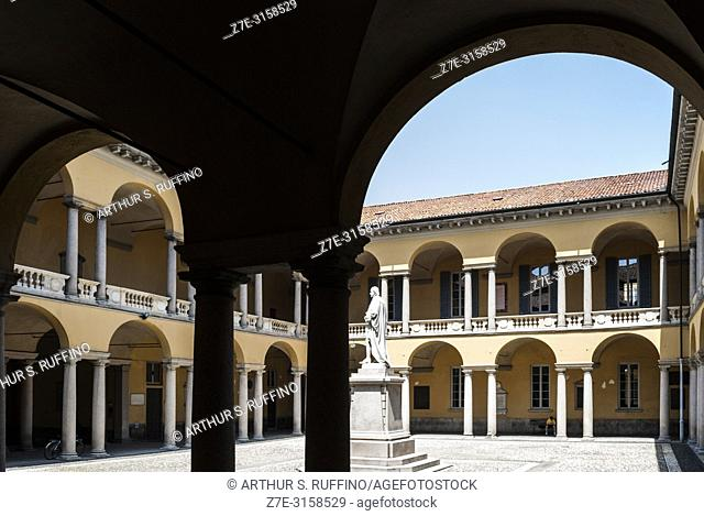 Statues in courtyard arcade. University of Pavia. Pavia, Lombardy, Italy, Europe