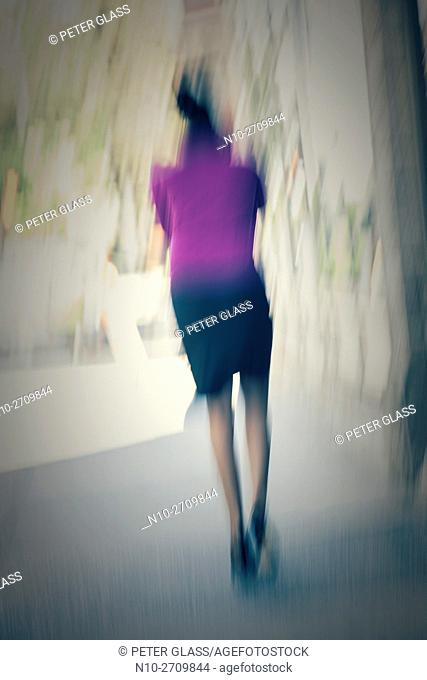 Blurred woman standing on city street