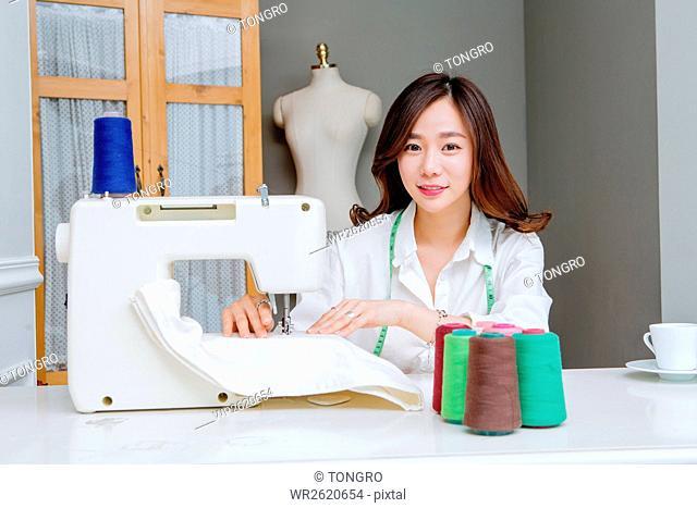 Portrait of smiling female fashion designer
