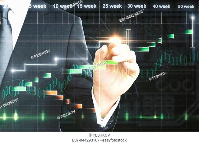 Unrecognizable businessman with creative forex chart interface. Finance and investment concept. Double exposure