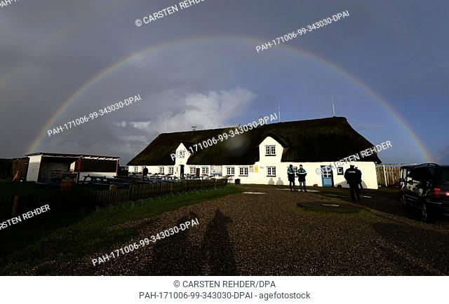 A rainbow can be seen over Hamburg Hallig, Germany, 6 October 2017. Photo: Carsten Rehder/dpa. - Hamburger Hallig/Schleswig-Holstein/Germany