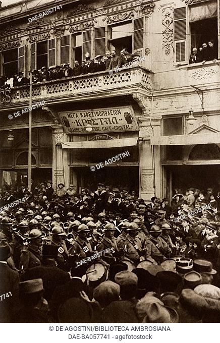 A huge crowd along a street attends the march of French soldiers on the Independence Day, Thessaloniki, Greece, First World War