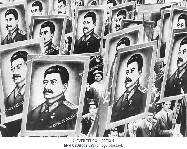 May Day parade in Bucharest, Romanian in 1952. Placards of identical portraits of Russian Soviet leader Stalin are carried by marchers