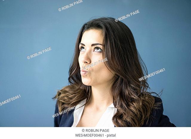 Portrait of businesswoman looking up