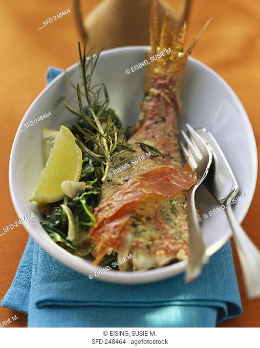 Oven-baked red mullet with Parma ham