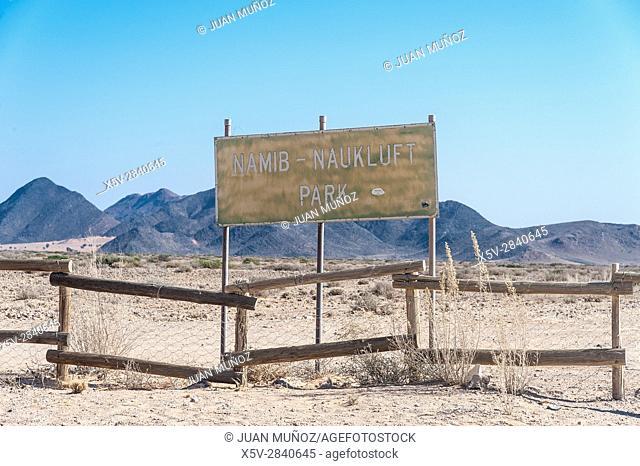 Poster and fence bordering the Namib-Naukluft National Park. Namibia