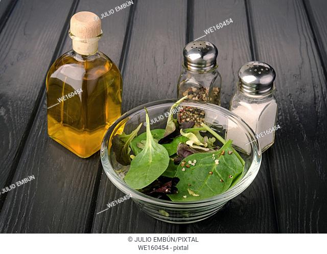 salad with vegetables and seeds in glass bowl on black board