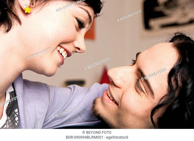 young couple tenderly looking at each other