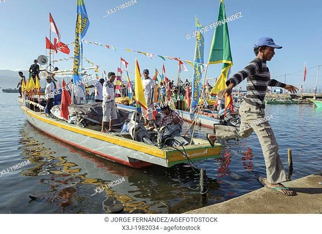 Man jumping off the boat during Jailolo festival celebrations, Maluku, Indonesia, Asia