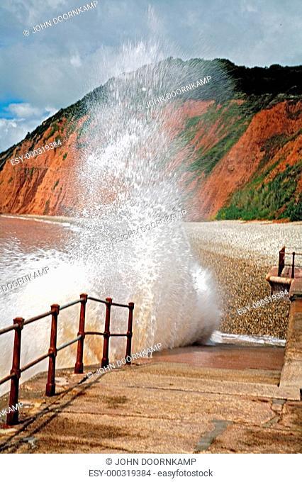 Devon, England, United Kingdom, Sea water spraying up against beach walkway