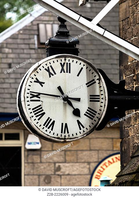 Vintage platform clock at Grosmont station on the North Yorkshire Moors Railway, near Whitby, North Yorkshire, UK