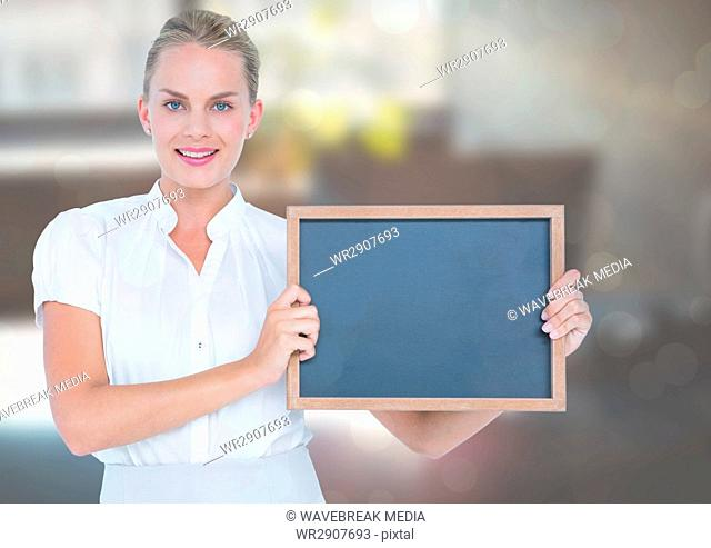 Business woman with blackboard in the office