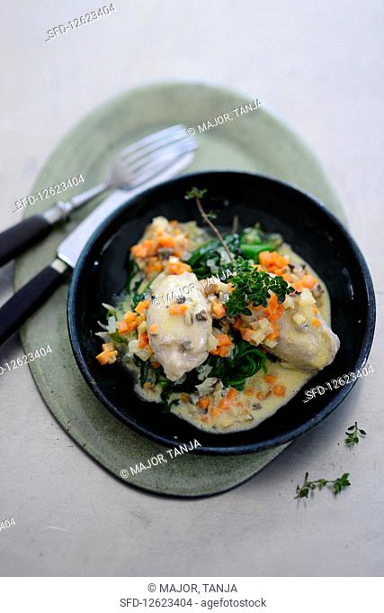Veal dumplings with a mustard sauce and leafy spinach