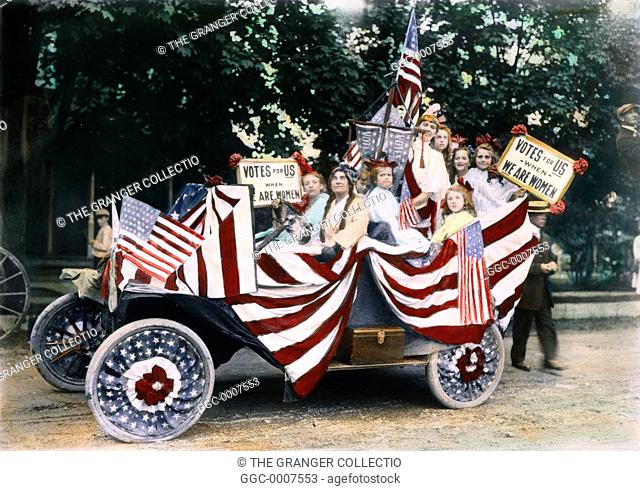 WOMEN'S SUFFRAGE, 1920.Young girls at an American suffrage meeting, c1920, in an automobile festooned with banners and placards reading