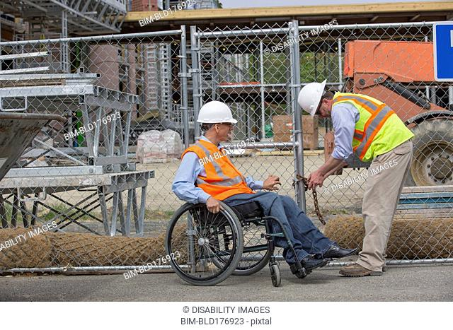 Caucasian engineers working on construction site