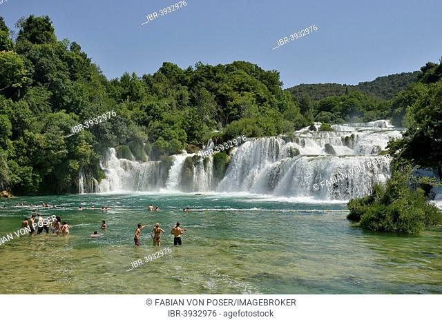 Tourists taking a bath at the Skradinski buk waterfalls, Krka National Park, Šibenik-Knin County, Dalmatia, Croatia