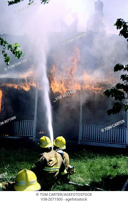 firefighters fighting a house fire in Bowie, Md