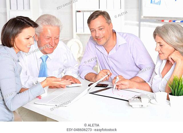 group of successful businesspeople working together in modern office, unity concept
