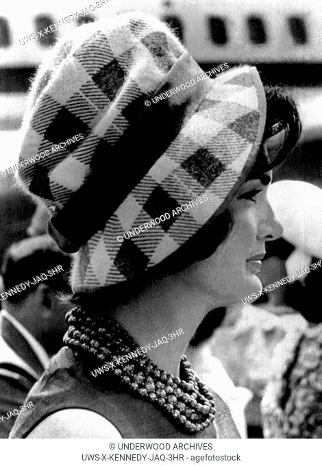 Andrews Air Force Base, Maryland: July 11, 1961.Jacqueline Kennedy wearing a checked blue and white high cloche with a matching blue ribbon around the crown as...