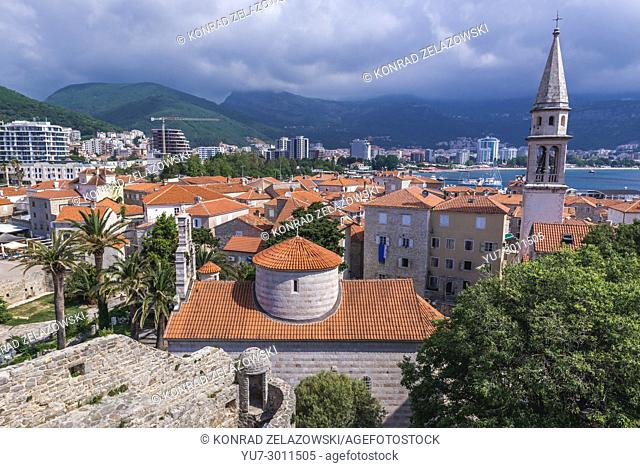 Aerial view from Citadel on the Old Town of Budva on the Adriatic Sea coast in Montenegro. Holy Trinity Church na Saint John Cathedral on photo
