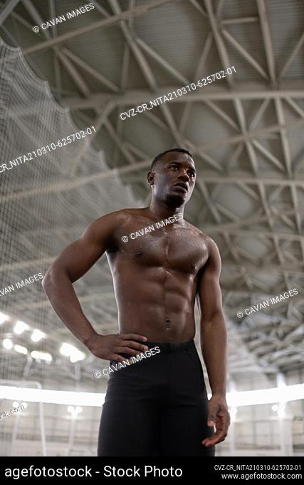 Exhausted African American runner resting