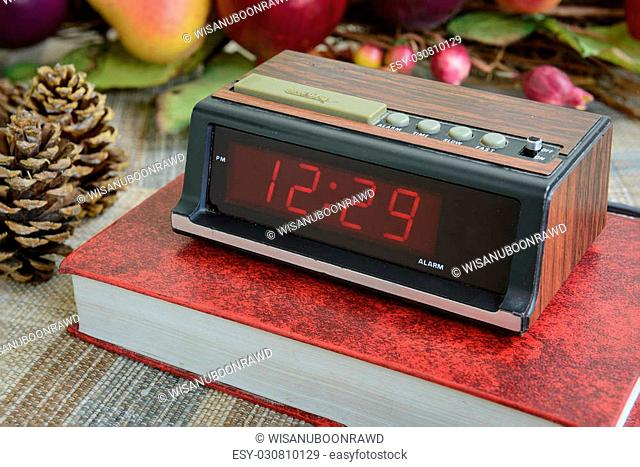 old digital alarm clock, grunge and old condition, wood paint