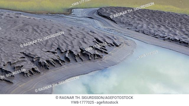 River bed, and mud flats with ash from volcanic eruptions, Virkisjokull Glacier on Vatnajokull Ice Cap, Iceland