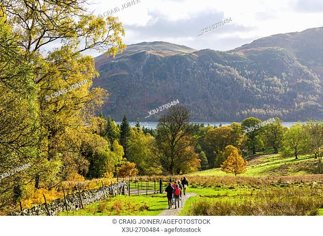 Walkers in the Aira Beck Valley with Ullswater, Sleet Fell and Birk Fell in the distance. Lake District National Park, Cumbria, England