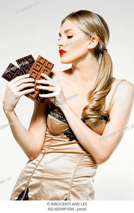 Young woman holding chocolate