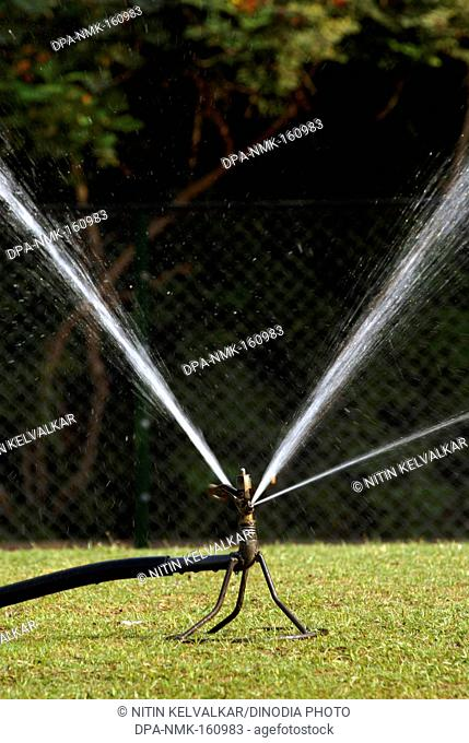 Water sprinkler with rotary nozzle at Saras Baug ; Pune ; Maharashtra ; India