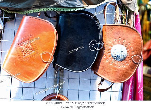 Three leather handbags in sevilla street market