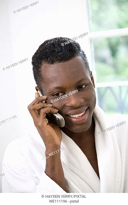 Young African Man Speaking on Mobile Phone