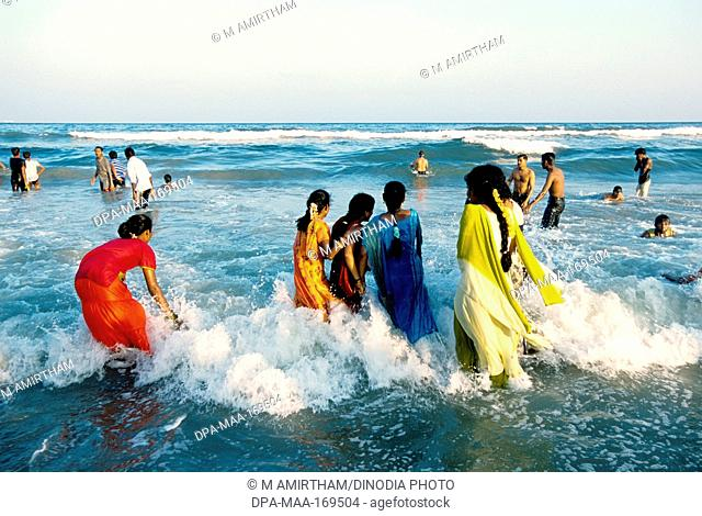 Tourists at marina beach in Madras Chennai , Tamil Nadu , India