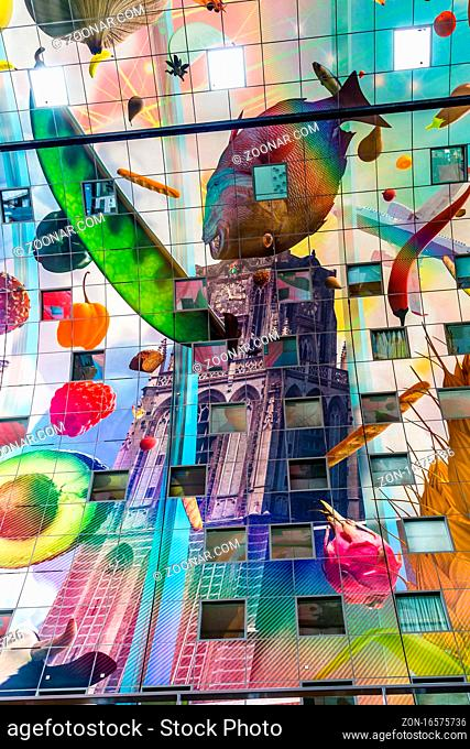 Rotterdam, Netherlands - June, 21 2018: Vibrant colors on the ceiling of the market hal. The Market Hall, a residential and office building with a fresh market...